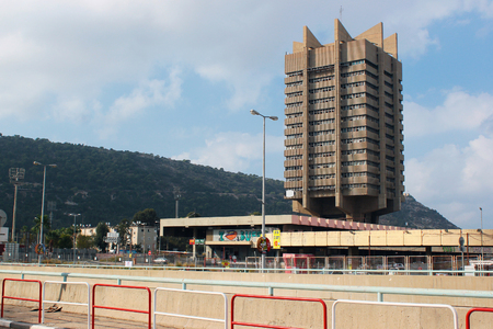 HAIFA, ISRAEL - DECEMBER 4,2013: Building of Bat Galim central bus station. Tower houses offices of Egged, the largest transportation company. Editorial