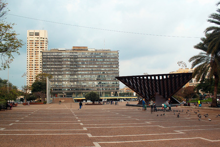 TEL AVIV, ISRAEL - DECEMBER 7,2013: Yitzhak Rabin square, named so after his assassination here in 1995. City Hall and Holocaust memorial by Igael Tumarkin. Editorial