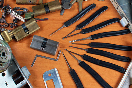 Locks and lockpicks at locksmiths workshop Stock Photo