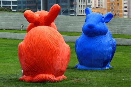 architect: BAKU, AZERBAIJAN - APRIL 24, 2017: Big colorful rabbits on green lawn as elements of landscape design near Heydar Aliyev Center, the building designed by world-famous architect Zaha Hadid. Editorial