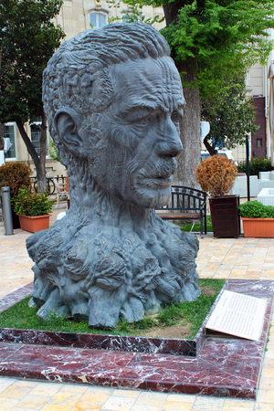 BAKU, AZERBAIJAN - APRIL 25, 2017: Sculpture head of Aliaga Vahid in Old City of Baku. Vahid was Azerbaijani poet, known for reintroducing medieval ghazel style in modern poetry. Editorial