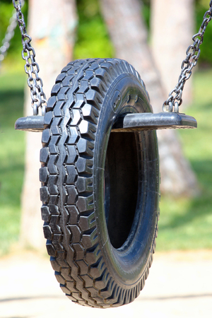Rubber tire on seesaw at children playground