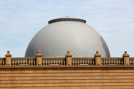 White dome behind balustrade on a rooftop Stock Photo