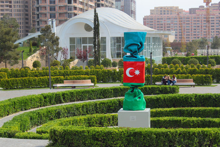 BAKU, AZERBAIJAN - APRIL 28, 2017: Azerbaijan by Laurence Jenkell, recognized  French artist and sculptor, 2013. Candy sweet colored as Azerbaijani flag is made of polyester and has 7m in height.