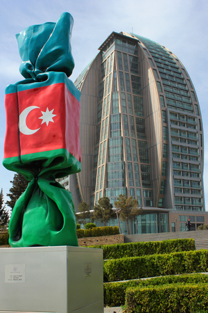 BAKU, AZERBAIJAN - APRIL 28, 2017: Trump Tower unfinished 5-star hotel and sculpture Azerbaijan by Laurence Jenkell, French artist and sculptor, 2013