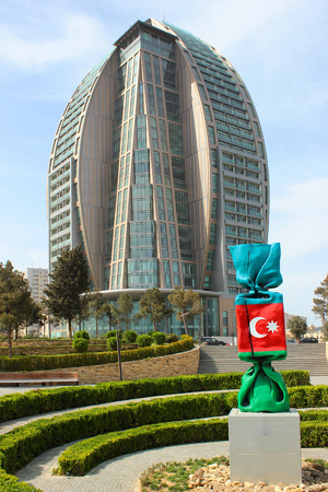 BAKU, AZERBAIJAN - APRIL 28, 2017: Trump Tower unfinished 5-star hotel and sculpture Azerbaijan by Laurence Jenkell, French artist and sculptor, 2013. Editorial