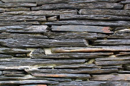 Flat granite stone slabs in a wall  Stok Fotoğraf