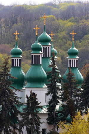 Green cupolas of Holy Trinity church at Kitaevo monastery in Kiev, Ukraine Stok Fotoğraf