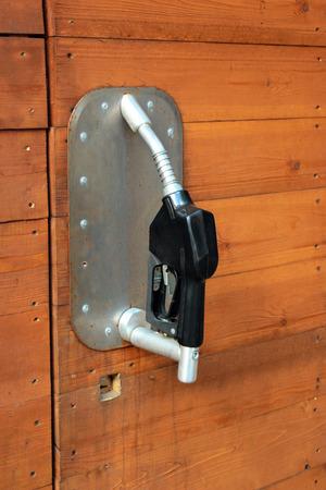 Garage door handle made of old fuel nozzle