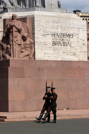 RIGA, LATVIA - JULY 10, 2017: Guard at the Freedom Monument, memorial honouring soldiers killed during the Latvian War of Independence. Editorial