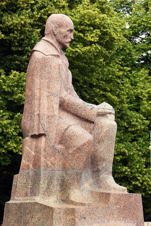 RIGA, LATVIA - JULY 10, 2017: Statue of Rainis (Janis Plieksans), a famous Latvian poet, playwright, translator, and politician in the Riga Esplanade park.