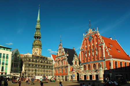 RIGA, LATVIA - JULY 10, 2017: House of the Blackheads and St. Peters church in Riga Old Town, UNESCO World Heritage Site.