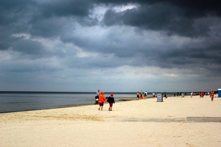 JURMALA, LATVIA - JULY 11, 2017: Jurmala, a seaside resort town on the Gulf of Riga with long stretch of white-sand beach, popular among Latvians and tourists. Summer day with dark overcast sky and low clouds. Editorial