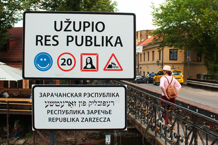 VILNIUS, LITHUANIA - JULY 12, 2017: Entrance sign to the Republic of Uzupis, a bohemic neighborhood in Vilnius, popular among artists, musicians and other creative people. Éditoriale