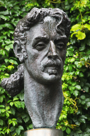 VILNIUS, LITHUANIA - JULY 13, 2017: Statue of Frank Zappa, an American musician, activist and filmmaker. He was famous for his nonconformity, free-form improvisation, sound experiments, musical virtuosity, and satire of American culture.
