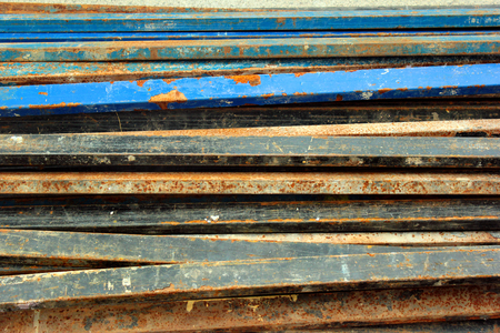 Rusty steel pipes with flaking paint