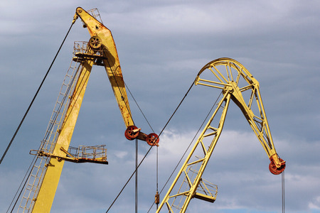 Two old harbor cranes