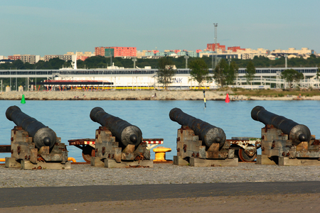 TALLINN, ESTONIA - JULY 8, 2017: Old cannons in the Estonian Maritime Museum at Seaplane Harbour, the historical area of Peter the Greats Naval Fortress. Redakční