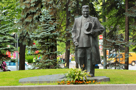 Riga, Latvia - July 10, 2017: Monument to Andrejs Upits near Riga Congress Hall. He was a Latvian teacher, poet, short story writer and Communist polemicist.