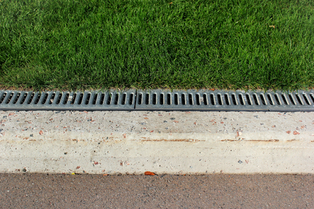 Kerbside and rainwater drainage system in a park  Imagens