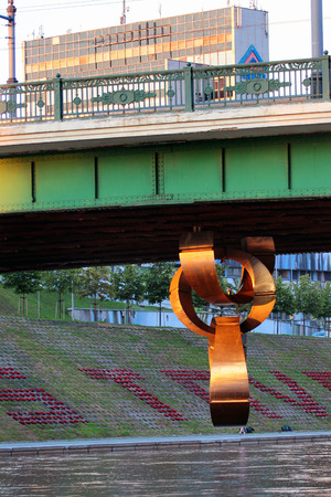 Vilnius, Lithuania - July 12, 2017: Sculpture Chain under Green Bridge in Vilnius   dedicated to sad moments of Lithuanian history - loss of independence, genocide,   occupation, exile.