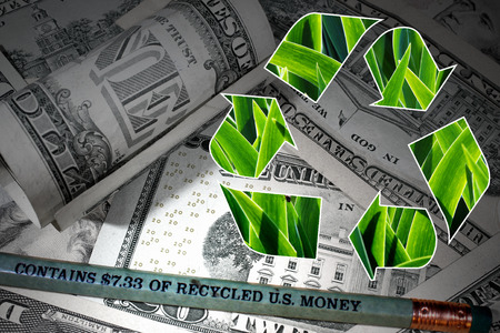 Pencil made of recycled U.S. dollar banknotes and recycle logo against paper money background Stock Photo