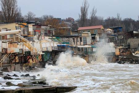 Coastal erosion - houses built on weak clay soil slide down to the sea and collapse in Odessa, Ukraine.