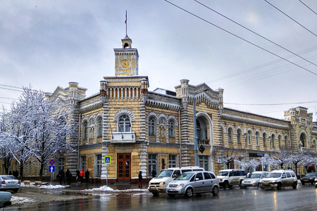 Chisinau, Moldova - December 18, 2017: Chisinau City Hall, built in 1898-1901 in Italian Gothic style by architects Mitrofan Elladi and Alexandru Bernardazzi.