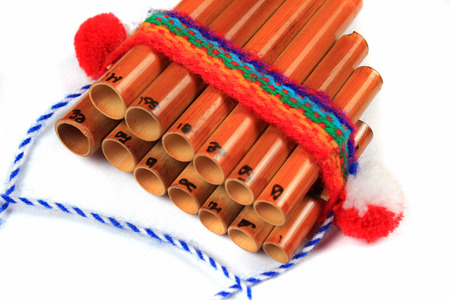 Pan flute on white background