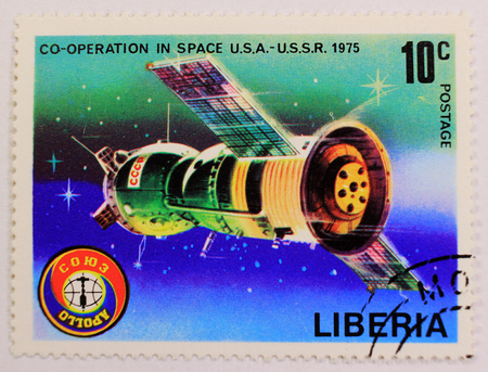 KHARKIV,UKRAINE - MARCH 5,2018: Old post stamp of Liberia, depicting cooperation in space between USA and USSR.
