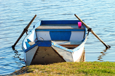 Empty punt boat at lakes shore