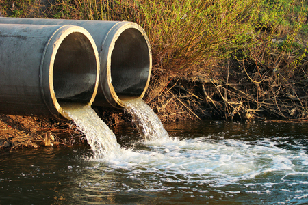 Discharge of sewage into a river 写真素材