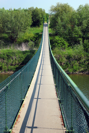 Footbridge over San river on Green Velo bicycle route, the longest consistently marked cycle trail in Eastern Poland. Stock Photo