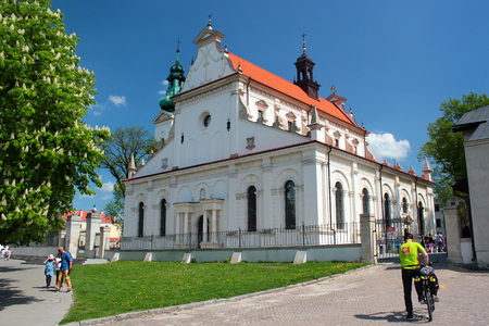 Zamosc, Poland - May 1, 2018: Zamosc Cathedral, former Collegiate Church, originally built in 1587. Old Town of Zamosc is UNESCO World Heritage Site and popular tourist destination.
