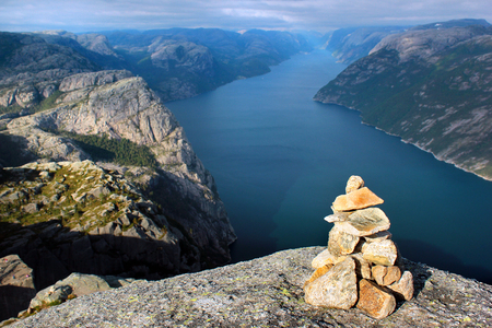 Stone cairn over Lysefjord and Preikestolen rock, Norway