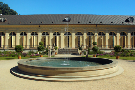 Warsaw, Poland - June 9, 2018: The Old Orangery in Lazienki Park, or Royal Baths, the largest park in Warsaw which occupies 76 hectares of the city center.