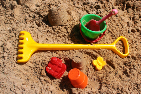 Children toys in a sandbox