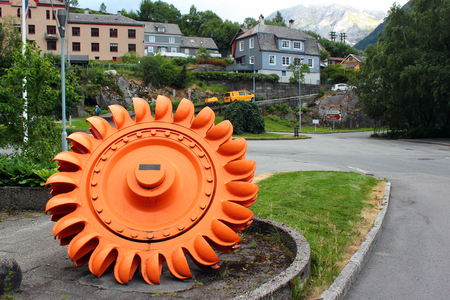 Tyssedal, Norway - June 22, 2018: Pelton wheel turbine as the symbol of the Tyssedal hydroelectric power station, which is now a part of the Norwegian Museum of Hydropower and Industry.