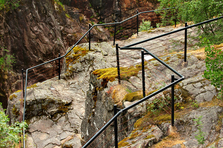 Metal railings at the cliff edge near Dorgefoss waterfall, Norway