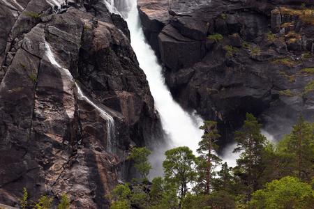 Nykkjesoyfossen falls, the third in cascade of four waterfalls in Husedalen valley, Kinsarvik, Norway
