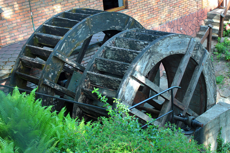Old wooden watermill wheels Stock Photo - 114396324