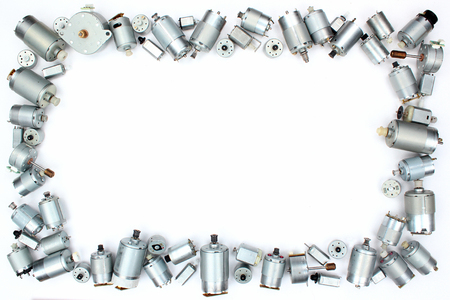 Many small electrical dc motors on white background