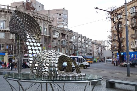 Dnipro, Ukraine - April 1, 2017: Replica of sculpture Marilyn by Joana Vasconcelos - elegant high-heeled sandal, made of stainless steel pans and lids. Editorial