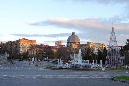 Madrid, Spain - December 18, 2016: The Higher Technical School of Industrial Engineers (ETSII), or The Industrial School of Madrid, with the monument of the Constitution on the Plaza San Juan de la Cruz.