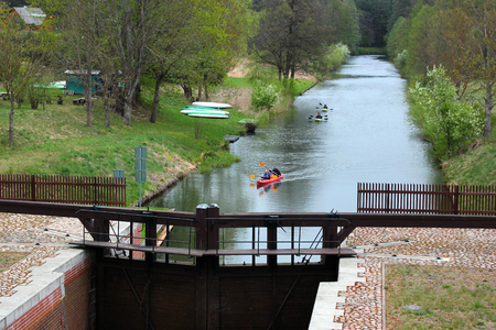 Mikaszowka, Poland: Kayakers approaching Mikaszowka Lock, the eleventh lock on the Augustow Canal in Poland, built in 1828.