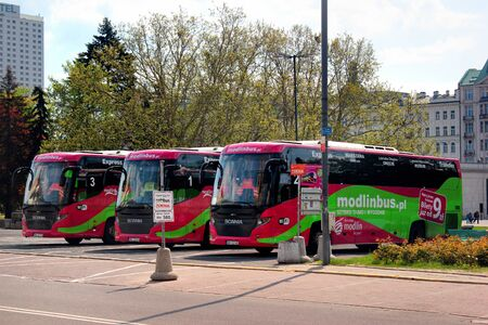 Warsaw, Poland - May 1, 2019: Buses of ModlinBus, the only carrier that offers direct bus connections from Warsaw Modlin Airport to Warsaw city centre.