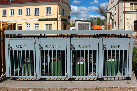 Barciany, Poland - May 5, 2019: Trash containers for different sorts of garbage - glass, plastic, paper and other sorted kinds of rubbish.