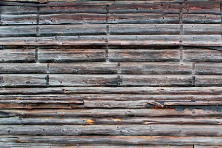 Old weathered wooden wall. Vintage timber blocking architectural background.