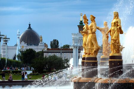 Moscow, Russia - June 23, 2019: The Friendship of Nations fountain at VDNKh, the Exhibition of Achievements of National Economy. 16 golden sculptures represent republics of the Soviet Union.