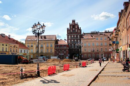 Bartoszyce, Poland - May 6, 2019: View of main Constitution square with Lidzbark Gate in the center of Bartoszyce, Warmian-Masurian Voivodeship, Polan Editöryel